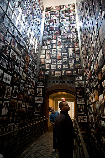 A gallery of memories at the United States Holocaust Memorial Museum in Washington DC. Every one of these photographs was selected out to take its place in the exhibit. A careful selection process is part of good curation of a physical exhibit, this is no less the case for building a digital archive.