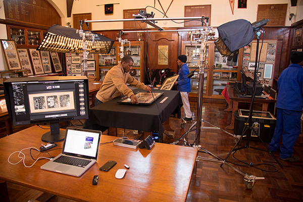 The team loading framed prints onto the table beneath our digitization rig in the Kingswood College Museum