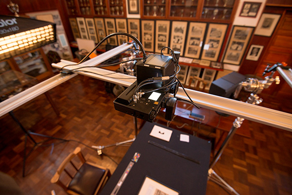 The Alpa 12 FPS camera with a Rodenstock lens and Phase One IQ3 100 digital back suspended on our digitization rig above a framed print