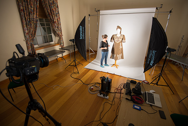 Student curator, Sarah Schäfer, assists with the setup of the digitisation of Iziko Museum's Isishweshwe collection.