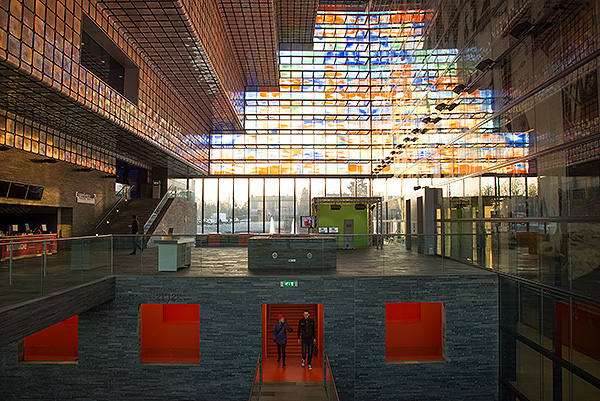 The fabulous mulitcoloured glass structure of Beeld en Geluid, The Netherlands Institute for Sound and Vision. Every day the Institute digitally archives all of The Netherland's public television and radio stations as well as a number of private stations. In the bowels of the building over 10 Petabytes of data are stored on LTO6 tape which is backed up to a similar facility in another building about a mile away.