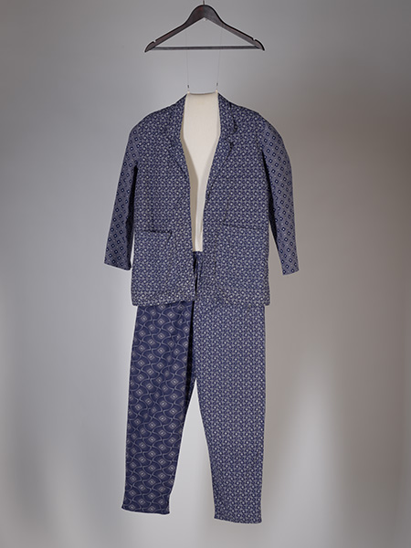 Jacket and trousers. Made and purchased in Johannesburg, Gauteng, 2009. Fabrics include Da Gama 'Three Leopards' and 'Six Star Toto.' Juliette Leeb-du Toit Collection, Iziko Soc Hist. 38