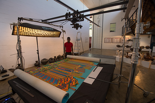 Mco Hlabe, a digitisation assistant at Africa Media Online looks on as we capture a Dereck Nxumalo painting at the Natal Society of Arts (NSA) Gallery in Durban, KwaZulu-Natal, South Africa. Africa Media Online was commissioned to capture the painting by Community Mural Projects in Durban. The 9 m long and 1.5 m high painting was captured in 33 overlapping tiles at 300 dpi and then stitched together to produce the finished digital file. The image was made with Africa Media Online's Alpa 12 FPS camera with a Rodenstock HR Digaron-S 60 mm f/4 lens and our Phase One IQ3 100 megapixel camera.