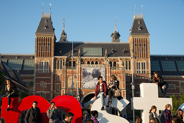 """Spring in Amsterdam. Crowds gather around the """"I Am Amsterdam"""" monument outside the Rijksmuseum."""