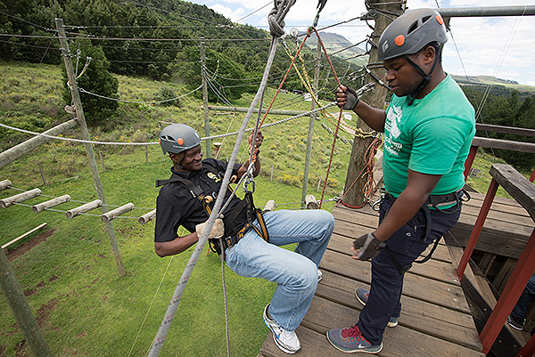 At the end of 2017 as part of our Christmas celebration, the team from NAHECS, the Africa Media Online team and representatives from the ANC and the funder had the privilege of engaging in a team building exercise in the Hogsback. Here Zalisile Victor Cakucaku abseils off a tower watched by an adventure guide. Bra Z, as he was affectionately called, tragically passed away from an infection in his leg in October 2017. He was greatly missed.