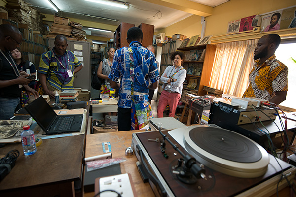 As part of the 49th international conference of the International Association of Sound and Audiovisual Archives (IASA) held at the University of Ghana, Legon, delegates got to tour various facilities to do with audiovisual archives. I joined in the tour of the Ghana Broadcasting Corporation. Here our tour group is introduced to the radio archive.